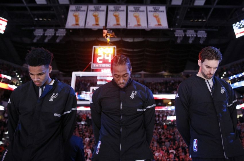 Oct 29, 2016; San Antonio, TX, USA; San Antonio Spurs forward Kawhi Leonard (middle) during the national anthem before a game against the New Orleans Pelicans at AT&T Center. Mandatory Credit: Soobum Im-USA TODAY Sports