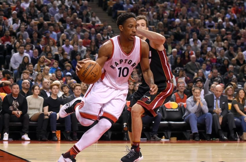 Nov 4, 2016; Toronto, Ontario, CAN; Toronto Raptors guard DeMar DeRozan (10) drives for a basket past Miami Heat guard Goran Dragic (7) in the second half at Air Canada Centre. DeRozan scored 34 points in a 96-87 win for Toronto. Mandatory Credit: Dan Hamilton-USA TODAY Sports