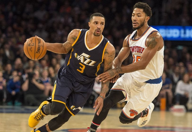 Nov 6, 2016; New York, NY, USA; Utah Jazz point guard George Hill (3) dribbles the ball against New York Knicks point guard Derrick Rose (25) during the fourth quarter at Madison Square Garden. Utah won 114-109. Mandatory Credit: Gregory J. Fisher-USA TODAY Sports