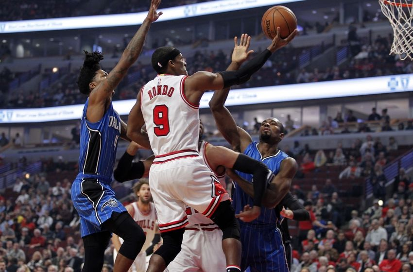 Nov 7, 2016; Chicago, IL, USA; Chicago Bulls guard Rajon Rondo (9) goes up for a layup while defended by Orlando Magic guard Elfrid Payton (4) during the first quarter of the game at United Center. Mandatory Credit: Caylor Arnold-USA TODAY Sports