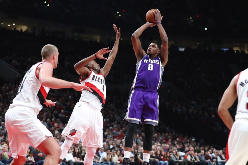 Nov 11, 2016; Portland, OR, USA; Sacramento Kings forward Rudy Gay (8) shoots over Portland Trail Blazers forward Maurice Harkless (4) in the first half at Moda Center at the Rose Quarter. Mandatory Credit: Jaime Valdez-USA TODAY Sports