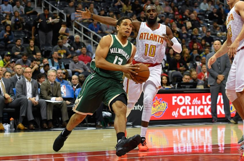 Nov 16, 2016; Atlanta, GA, USA; Milwaukee Bucks guard Malcolm Brogdon (13) dribbles the ball past Atlanta Hawks guard Tim Hardaway Jr. (10) during the first half at Philips Arena. Mandatory Credit: Dale Zanine-USA TODAY Sports