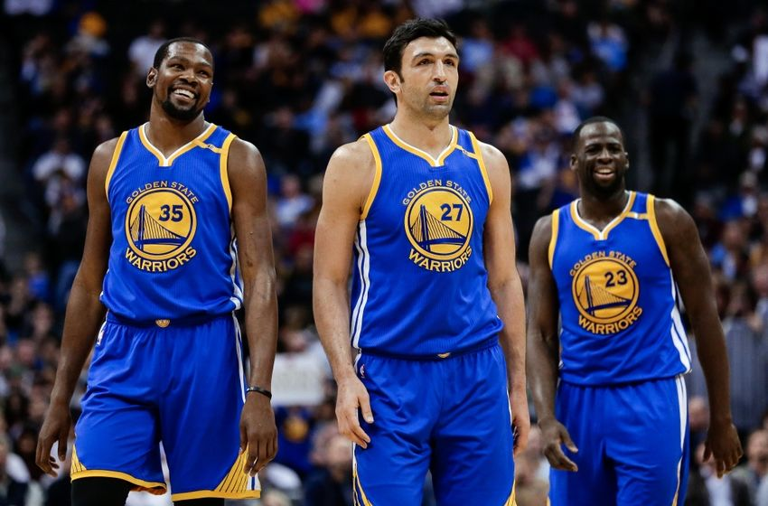 Nov 10, 2016; Denver, CO, USA; Golden State Warriors center Zaza Pachulia (27) and forward Kevin Durant (35) and forward Draymond Green (23) in the third quarter against the Denver Nuggets at the Pepsi Center. Mandatory Credit: Isaiah J. Downing-USA TODAY Sports