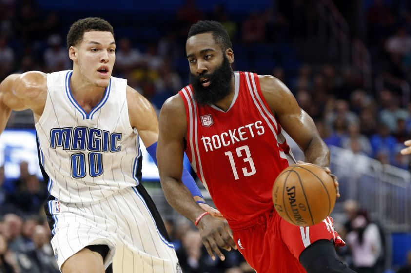 Jan 6, 2017; Orlando, FL, USA; Houston Rockets guard James Harden (13) drives to the basket as Orlando Magic forward Aaron Gordon (00) defends during the first quarter at Amway Center. Mandatory Credit: Kim Klement-USA TODAY Sports