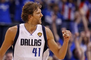 Dallas Mavericks' Dirk Nowitzki celebrates his basket against the Miami Heat in the fourth quarter during Game 5 of the NBA Finals basketball series in Dallas