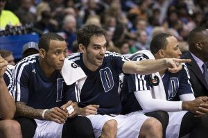 Nov 27, 2013; Dallas, TX, USA; Dallas Mavericks shooting guard Monta Ellis (11) and point guard Jose Calderon (8) watch the game against the Golden State Warriors from the bench during the first half at the American Airlines Center. Mandatory Credit: Jerome Miron-USA TODAY Sports
