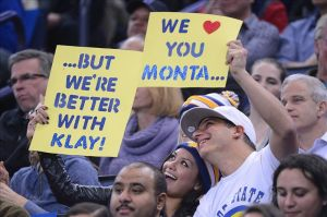 December 11, 2013; Oakland, CA, USA; Golden State Warriors fans hold up signs for Dallas Mavericks shooting guard Monta Ellis (11, not pictured) and Warriors shooting guard Klay Thompson (11, not pictured) during the first quarter at Oracle Arena. The Warriors defeated the Mavericks 95-93. Mandatory Credit: Kyle Terada-USA TODAY Sports