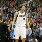 Mar 25, 2014; Dallas, TX, USA; Dallas Mavericks forward Dirk Nowitzki (41) reacts after hitting a three point basket in overtime against the Oklahoma City Thunde at American Airlines Center. Mandatory Credit: Matthew Emmons-USA TODAY Sports