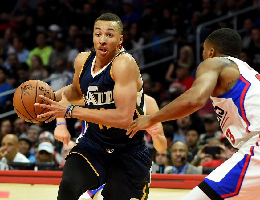 3d04c265765 Oct 30, 2016; Los Angeles, CA, USA; Utah Jazz guard Dante Exum (11) drives  to the basket against Los Angeles Clippers forward Wesley Johnson (33) in  the ...