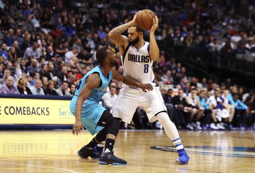 9727796-deron-williams-kemba-walker-nba-charlotte-hornets-dallas-mavericks