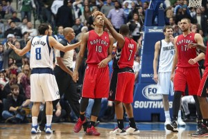 Dec 20, 2013; Dallas, TX, USA; Toronto Raptors shooting guard DeMar DeRozan (10) and point guard Kyle Lowry (7) celebrate after a score during the fourth quarter against the Dallas Mavericks at American Airlines Center. Mandatory Credit: Kevin Jairaj-USA TODAY Sports