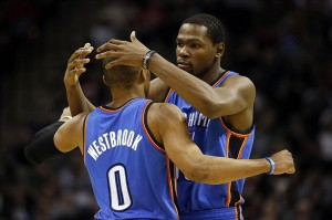 Dec 21, 2013; San Antonio, TX, USA; Oklahoma City Thunder guard Russell Westbrook (0) celebrates a score with forward Kevin Durant (3right) during the second half against the San Antonio Spurs at AT