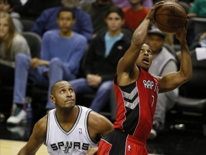 Dec 23, 2013; San Antonio, TX, USA; Toronto Raptors guard Kyle Lowry (7) drives to the basket as San Antonio Spurs forward Boris Diaw (33) looks on during the second half at AT