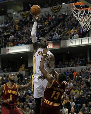 Dec 31, 2013; Indianapolis, IN, USA; Indiana Pacers center Roy Hibbert (55) shoots over Cleveland Cavaliers power forward Tristan Thompson (13) during the third quarter at Bankers Life Fieldhouse. The Pacers won 91-76. Mandatory Credit: Pat Lovell-USA TODAY Sports