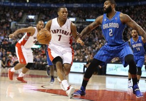 Jan 29, 2014; Toronto, Ontario, CAN; Toronto Raptors point guard Kyle Lowry (7) moves the ball against the defense of Orlando Magic forward Kyle O