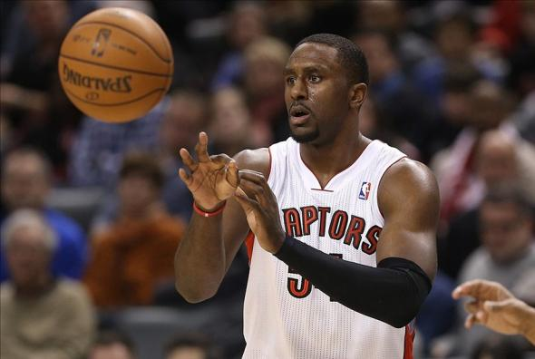 Dec 28, 2013; Toronto, Ontario, CAN; Toronto Raptors forward Patrick Patterson (54) passes the ball against the New York Knicks at Air Canada Centre. The Raptors beat the Knicks 115-100. Mandatory Credit: Tom Szczerbowski-USA TODAY Sports