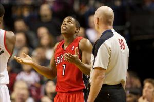 Feb 1, 2014; Portland, OR, USA; Toronto Raptors point guard Kyle Lowry (7) reacts to NBA referee Gary Zielinski (59) in the first half against the Portland Trail Blazers at Moda Center. Mandatory Credit: Jaime Valdez-USA TODAY Sports
