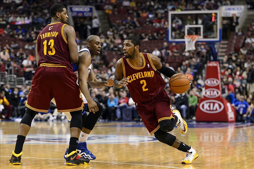 Feb 18, 2014; Philadelphia, PA, USA; Cleveland Cavaliers guard Kyrie Irving (2) goes around a pick set by forward Tristan Thompson (13) during the third quarter against the Philadelphia 76ers at the Wells Fargo Center. The Cavaliers defeated the Sixers 114-85. Mandatory Credit: Howard Smith-USA TODAY Sports