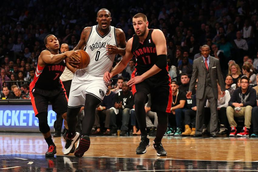 Apr 25, 2014; Brooklyn, NY, USA; Brooklyn Nets center Andray Blatche (0) drives between Toronto Raptors guard Kyle Lowry (7) and forward Amir Johnson (15) during the fourth quarter in game three of the first round of the 2014 NBA Playoffs at Barclays Center. Brooklyn Nets won 102-98. Mandatory Credit: Anthony Gruppuso-USA TODAY Sports