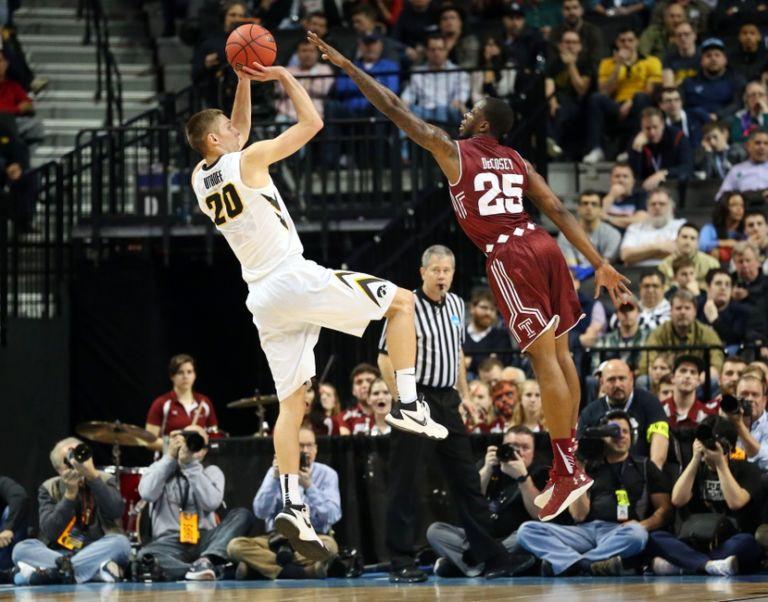 Quenton-decosey-jarrod-uthoff-ncaa-basketball-ncaa-tournament-first-round-iowa-vs-temple-768x602