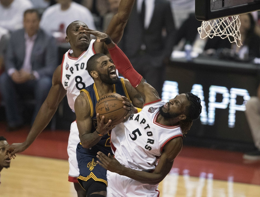 May 27, 2016; Toronto, Ontario, CAN; Cleveland Cavaliers guard Kyrie Irving (2) drives to the basket as Toronto Raptors forward DeMarre Carroll (5) tries to defend during the first quarter of game six of the Eastern conference finals of the NBA Playoffs at Air Canada Centre. Mandatory Credit: Nick Turchiaro-USA TODAY Sports