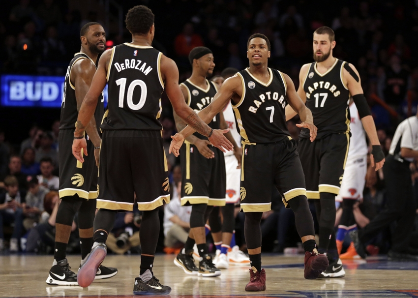 9244439-demar-derozan-kyle-lowry-nba-toronto-raptors-new-york-knicks