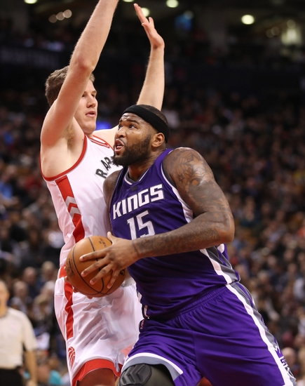 Nov 6, 2016; Toronto, Ontario, CAN; Sacramento Kings center DeMarcus Cousins (15) goes to the basket against Toronto Raptors cenetr Jakob Poeltl (42) at Air Canada Centre. The Kings beat the Raptors 96-91. Mandatory Credit: Tom Szczerbowski-USA TODAY Sports
