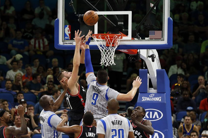 Dec 18, 2016; Orlando, FL, USA; Orlando Magic center Nikola Vucevic (9) shoots over Toronto Raptors center Jonas Valanciunas (17) during the second quarter at Amway Center. Mandatory Credit: Kim Klement-USA TODAY Sports