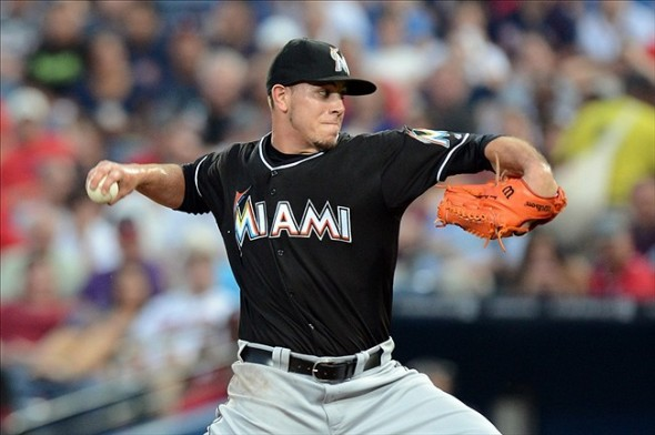 Aug 30, 2013; Atlanta, GA, USA; Miami Marlins starting pitcher Jose Fernandez (16) pitches against the Atlanta Braves during the first inning at Turner Field. Mandatory Credit: Dale Zanine-USA TODAY Sports