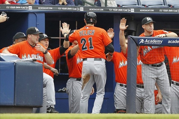 Sep 1, 2013; Atlanta, GA, USA; Miami Marlins left fielder Christian Yelich (21) is congratulated by teammates after scoring a run against the Atlanta Braves in the first inning at Turner Field. Mandatory Credit: Brett Davis-USA TODAY Sports