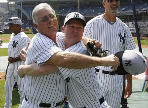 July 1, 2012; Bronx, NY, USA; New York Yankees former players Bucky Dent and Pat Kelly hug before the Old Timers Day game before the MLB game against the Chicago White Sox at Yankee Stadium. Mandatory Credit: William Perlman/THE STAR-LEDGER via USA TODAY Sports