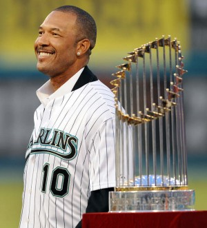 Miami Gardens--- fl-marlins-last-game-sun-life-0929t--- The Florida Marlins host the Washington Nationals for the final Marlins game ever at Sun Life Stadium. Ex-Marlin Gary Sheffield smiles as he stands next to one of two World Series trophies that the Marlins have won. Robert Duyos, Sun Sentinel