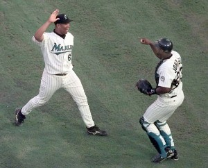 Marlins' pitcher Livan Hernandez , celebrating with catcher Charles… (ROBERT MAYER, Sun Sentinel )
