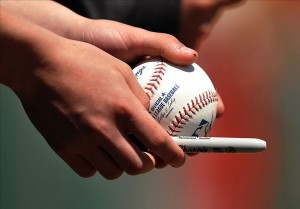 March 28, 2013; Jupiter, FL, USA; A close up view of an official major league baseball in the hands of a fan seeking autographs during the spring training game between the Miami Marlins and the St. Louis Cardinals at Roger Dean Stadium. Mandatory Credit: Brad Barr-USA TODAY Sports