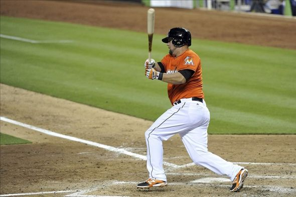 Mar 31, 2014; Miami, FL, USA; Miami Marlins third baseman Casey McGehee (9) connects for a three run RBI double in the fifth inning of an opening day baseball game against the Colorado Rockies at Marlins Ballpark. Mandatory Credit: Steve Mitchell-USA TODAY Sports