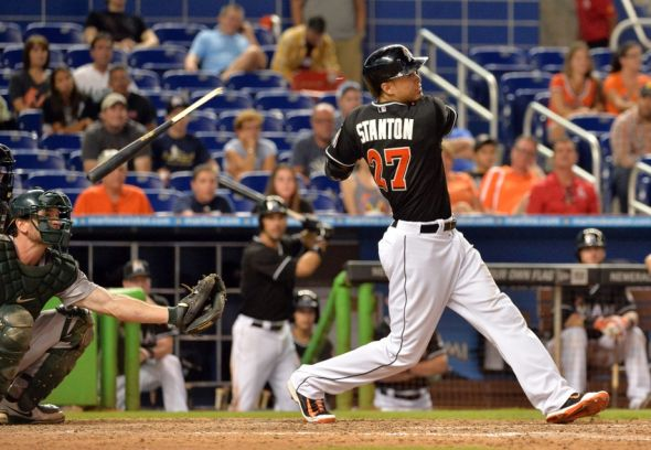 Jun 28, 2014; Miami, FL, USA; Miami Marlins right fielder Giancarlo Stanton (27) breaks his bat after hitting a single during the 14th inning against the Oakland Athletics at Marlins Ballpark. The Oakland Athletics won 7-6 in 14th inning. Mandatory Credit: Steve Mitchell-USA TODAY Sports