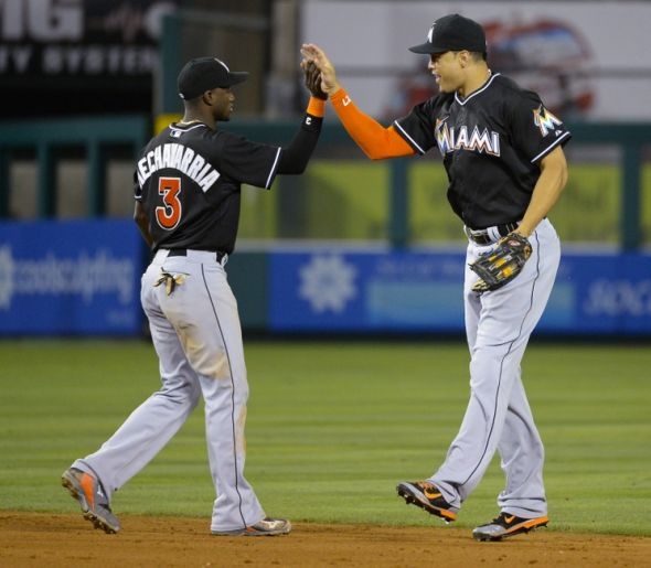 Aug 25, 2014; Anaheim, CA, USA; Miami Marlins right fielder Giancarlo Stanton (right) and shortstop Adeiny Hechavarria (3) celebrate the victory against the Los Angeles Angels at Angel Stadium of Anaheim. Mandatory Credit: Richard Mackson-USA TODAY Sports