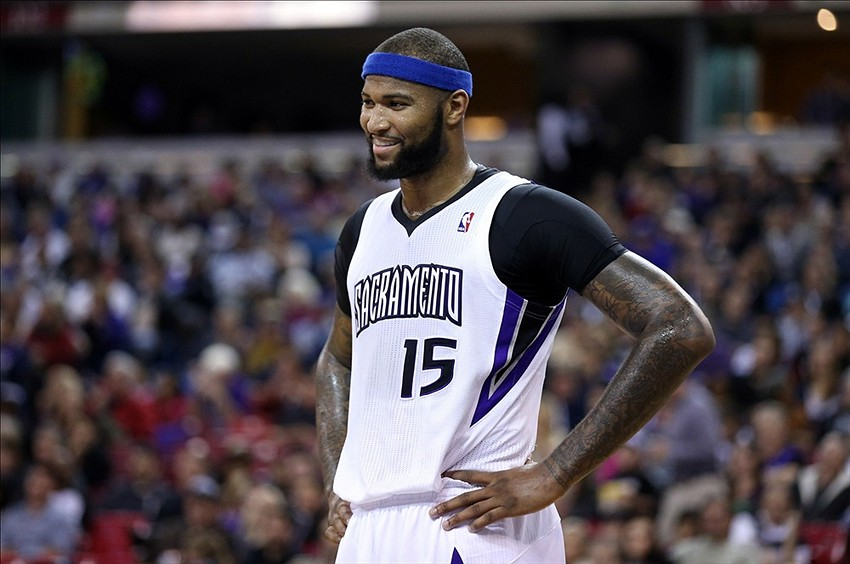 Jan 7, 2014; Sacramento, CA, USA; Sacramento Kings center DeMarcus Cousins (15) smiles as a call is reviewed during the first quarter against the Portland Trail Blazers at Sleep Train Arena. Mandatory Credit: Kelley L Cox-USA TODAY Sports