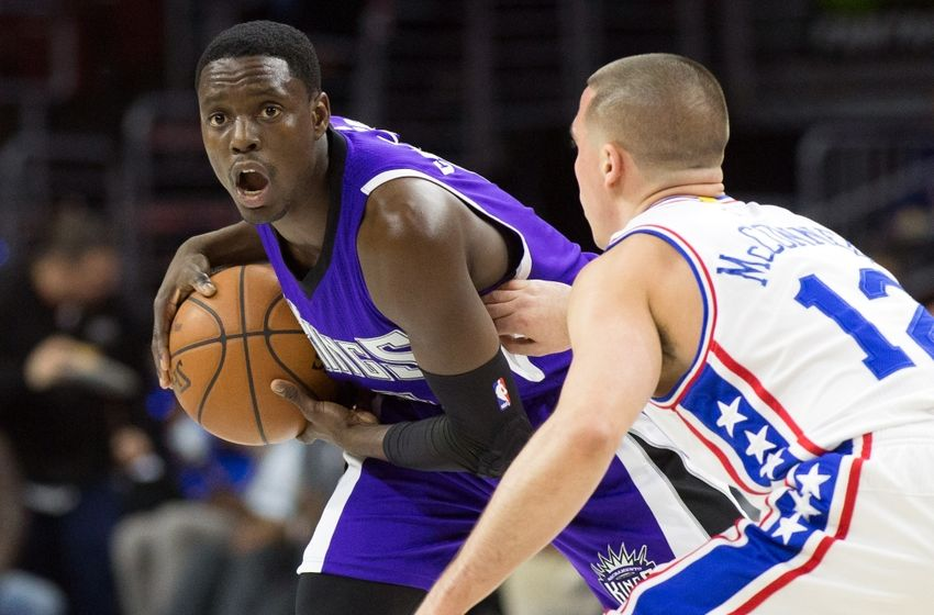 Feb 10, 2016; Philadelphia, PA, USA; Sacramento Kings guard Darren Collison (7) looks for an opening past Philadelphia 76ers guard T.J. McConnell (12) during the second quarter at Wells Fargo Center. Mandatory Credit: Bill Streicher-USA TODAY Sports