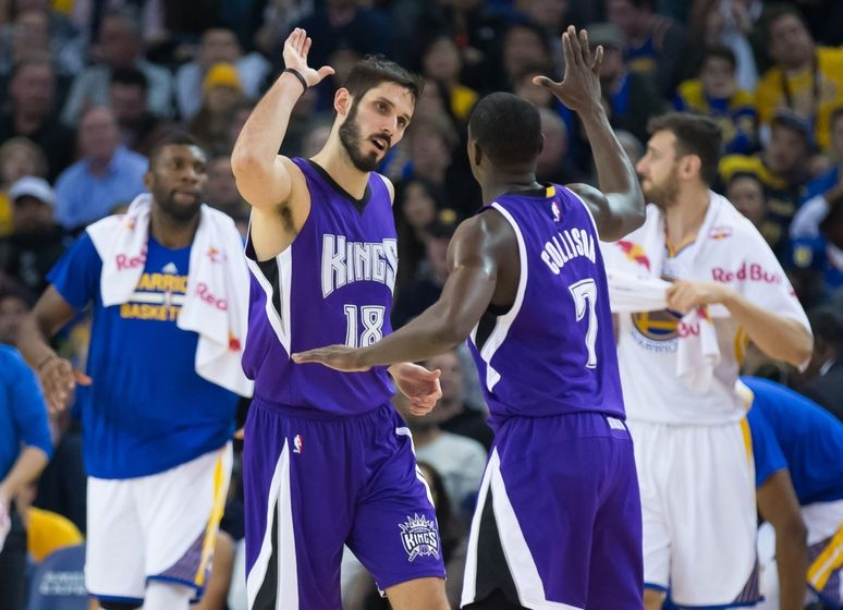 Dec 28, 2015; Oakland, CA, USA; Sacramento Kings forward Omri Casspi (18) high fives guard Darren Collison (7) against the Golden State Warriors during the second quarter at Oracle Arena. Mandatory Credit: Kelley L Cox-USA TODAY Sports