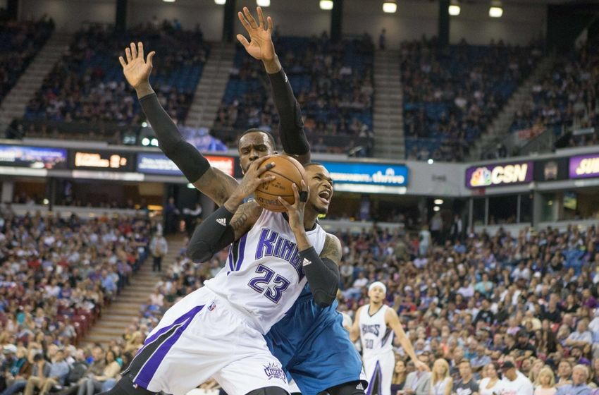 Apr 7, 2016; Sacramento, CA, USA; Sacramento Kings guard Ben McLemore (23) drives in against Minnesota Timberwolves forward Shabazz Muhammad (15) in the fourth quarter at Sleep Train Arena. The Minnesota Timberwolves defeated the Sacramento Kings 105 to 97. Mandatory Credit: Neville E. Guard-USA TODAY Sports