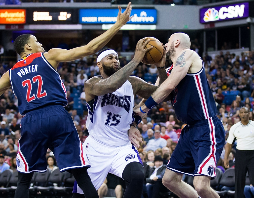 9219737-demarcus-cousins-marcin-gortat-otto-porter-jr-nba-washington-wizards-sacramento-kings