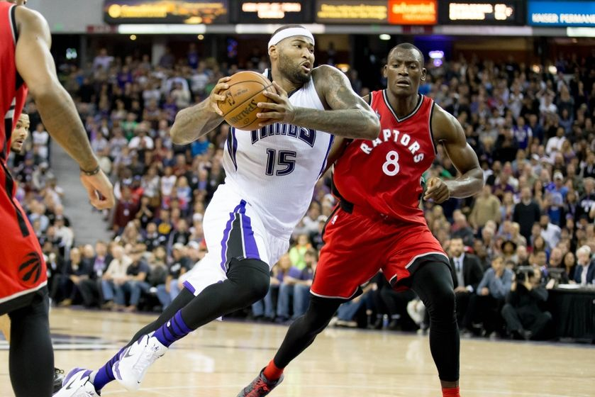Nov 15, 2015; Sacramento, CA, USA; Sacramento Kings forward DeMarcus Cousins (15) moves in against Toronto Raptors forward Bismack Biyombo (8) during the fourth quarter at Sleep Train Arena. The Sacramento Kings defeated the Toronto Raptors 107-101. Mandatory Credit: Kelley L Cox-USA TODAY Sports