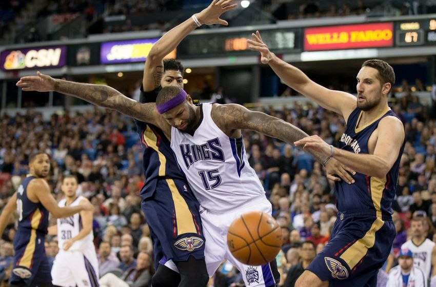 Jan 13, 2016; Sacramento, CA, USA; Sacramento Kings center DeMarcus Cousins (15) loses the ball between New Orleans Pelicans forward Anthony Davis (23) and forward Ryan Anderson (33) during the fourth quarter at Sleep Train Arena. New Orleans defeated Sacramento 109-97. Mandatory Credit: Kelley L Cox-USA TODAY Sports