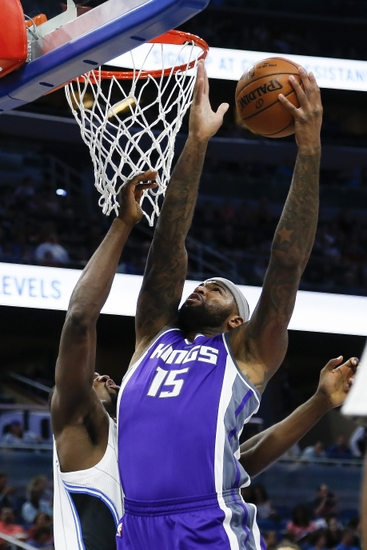 Nov 3, 2016; Orlando, FL, USA; Sacramento Kings center DeMarcus Cousins (15) goes up for a shot in the first quarter as Orlando Magic forward Serge Ibaka (7) defends at Amway Center. Mandatory Credit: Logan Bowles-USA TODAY Sports