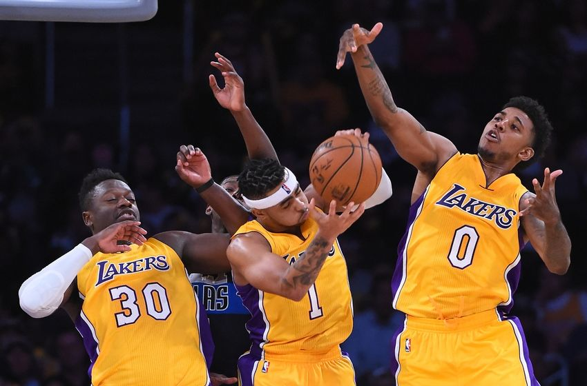 Nov 8, 2016; Los Angeles, CA, USA; Los Angeles Lakers guard D'Angelo Russell (1), forward Julius Randle (30) and guard Nick Young (0) go for a rebound in the second half of the game against the Dallas Mavericks at Staples Center. Mavericks won 109-97. Mandatory Credit: Jayne Kamin-Oncea-USA TODAY Sports