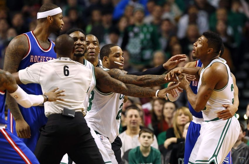 Dec 31, 2014; Boston, MA, USA; Referee Tony Brown (6) and Boston Celtics guard Jameer Nelson (28) try to separate Sacramento Kings center DeMarcus Cousins (15) and Boston Celtics guard Marcus Smart (right) during the second half of the Boston Celtics 106-84 win over the Sacramento Kings at TD Garden. Both players received a technical foul on the play. Mandatory Credit: Winslow Townson-USA TODAY Sports