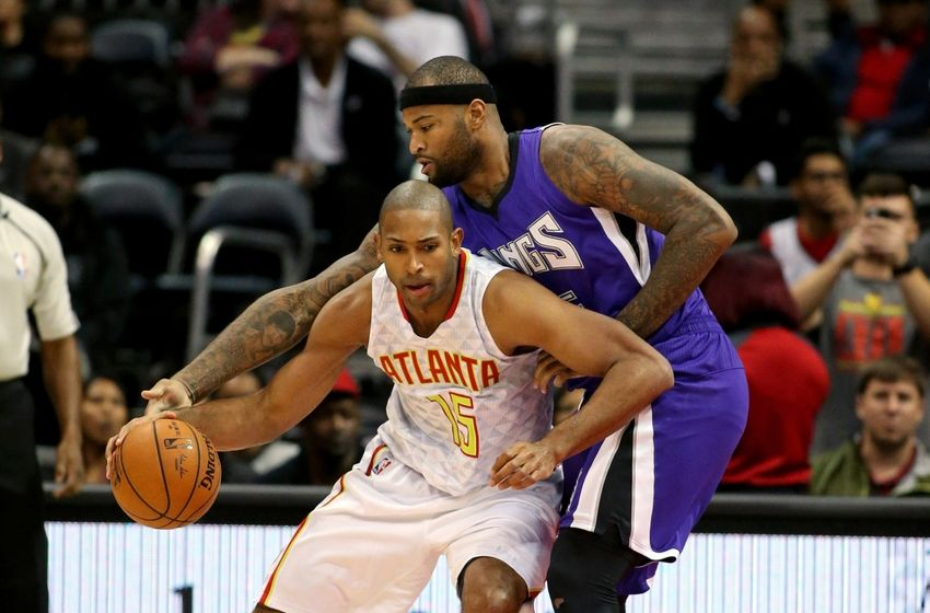 Nov 18, 2015; Atlanta, GA, USA; Atlanta Hawks center Al Horford (15) drives against Sacramento Kings forward DeMarcus Cousins (15) in the first quarter of their game at Philips Arena. Mandatory Credit: Jason Getz-USA TODAY Sports