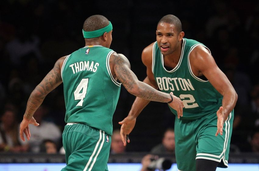 Nov 23, 2016; Brooklyn, NY, USA; Boston Celtics point guard Isaiah Thomas (4) celebrates with Boston Celtics center Al Horford (42) during the third quarter at Barclays Center. Mandatory Credit: Brad Penner-USA TODAY Sports