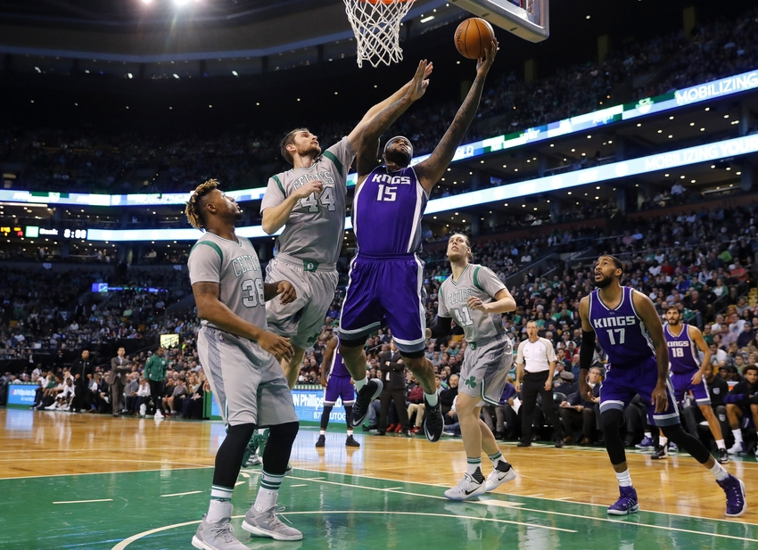 9717669-demarcus-cousins-tyler-zeller-nba-sacramento-kings-boston-celtics